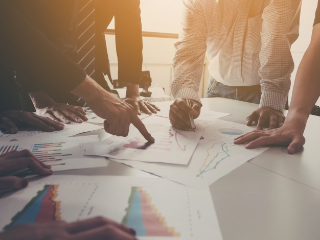 https://anilabashllari.com/wp-content/uploads/2019/06/group-businessman-meeting-analyze-company-performance-growth-corporate-with-information-data-paper_20693-135-1.jpg